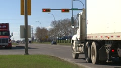 Trucking, intersection turning semi several zoom Stock Footage
