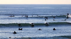 Surfer group 01 - many catch a wave Stock Footage