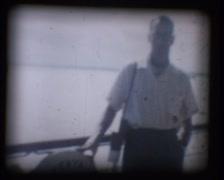 Vintage 8mm Film, Man on deck of Ship Kenya 1960s GFSD Stock Footage