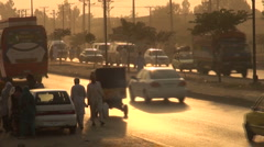 Pakistan traffic at sunset Stock Footage