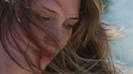 Stock Video Footage of HD1080 Young woman emotional face on the beach. Close Up. Slow Motion. Version 1