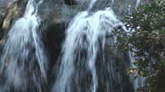 A waterfall cascading down a rocky edge Stock Footage