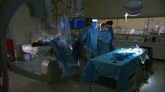 Doctors preparing surgical equipment Stock Footage