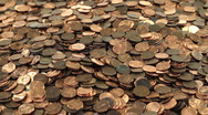 Stock Video Footage of Pennies through the fingers1