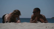 Stock Video Footage of HD720p50 Happy young couple relaxing on the beach.