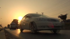 Sun sets over Islamabad traffic - stock footage