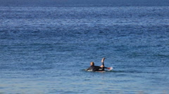 Surfer 02 - paddling out to sea Stock Footage