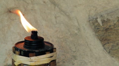 Closeup of Burning garden torch on the wall Stock Footage