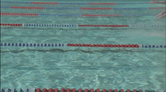 A group of men race to the other side of the pool. Stock Footage