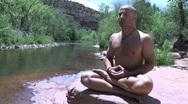 Man Does Meditation Pose at Creek 2 Stock Footage