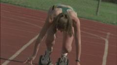 Female runners begin a race. - stock footage