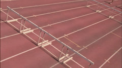 Female runners jump over hurdles. Stock Footage