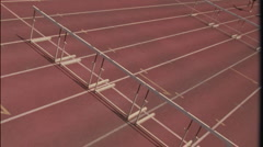 A group of racers jump over hurdles. Stock Footage