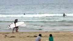 Surfers Walking Beach- Venice Beach, CA Stock Footage