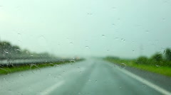 Car driving and Rain drops on the glass Stock Footage