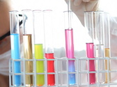 Scientist female mixing chemicals in test tube NTSC Stock Footage