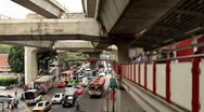 Stock Video Footage of Traffic jam and crowded people passing by in downtown Bangkok