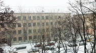 Snowfall on city street, high angle view Stock Footage