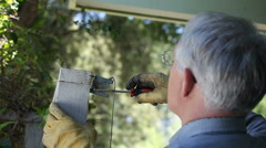 repairing gate latch - stock footage