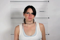 Female Criminal Mugshot Stock Footage