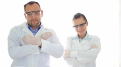 Male and female scientist in protective glasses looking to camera HD - stock footage