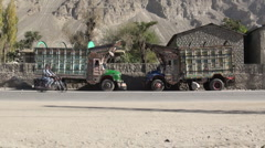 Two trucks parked in Pakistan village Stock Footage