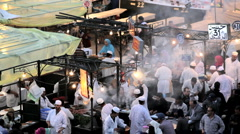 People cooking at the food Stalls Djemma El- Fna Square, Marrakech, Morocco Stock Footage