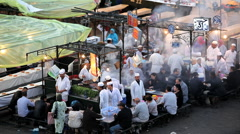 People eating at the food Stalls Djemma El- Fna Square, Marrakech, Morocco Stock Footage
