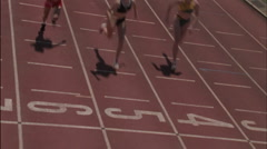 Female racers reach the finish line. - stock footage