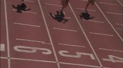 Three women run on a running track. Stock Footage