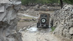 Crossing rocky path with jeep in Northern Pakistan Stock Footage