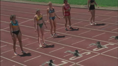 Five girls step up to the blocks and prepare to race. Stock Footage