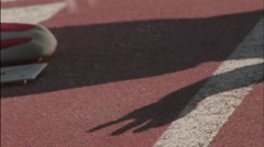An athlete on a track gets ready to run. Stock Footage