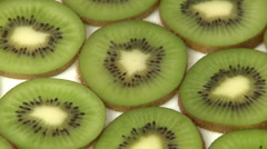 Slices of kiwi fruit closeup Stock Footage