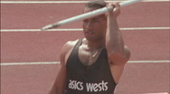 A man runs and  throws a javelin. Stock Footage