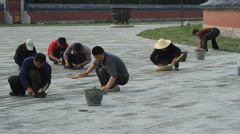 Workers repairing the grounds of the Temple of Heaven, Beijing, China - 3 Stock Footage