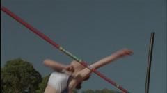A woman does a high jump over a bar. Stock Footage