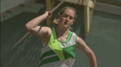 A young woman throws a javelin. Stock Footage