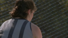 A women hammer thrower competing in an sporting event. Stock Footage