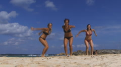 Happy girls on beach Stock Footage