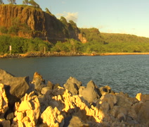 Molokai WS ocean pond, mountain, white rocks - stock footage