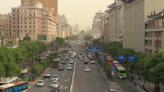 Xian street with Bell Tower in BG - Wide - 3 Stock Footage