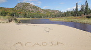 Beehive Mountain and Acadia written in sand Stock Footage