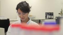 Scientist looking at liquid in laboratory Stock Footage