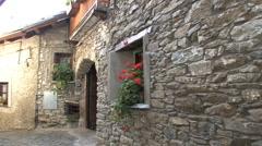 Italy Piedmont flowers in village window Stock Footage