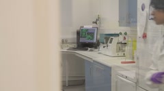 Female Scientist walks into science laboratory Stock Footage