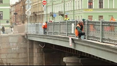 Worker paints the railing of the bridge Stock Footage