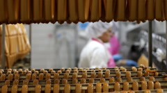 Production of hot dogs in a factory - stock footage