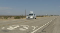 Car passing route66 sign Stock Footage