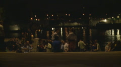 People in Paris dance next to the water Stock Footage
